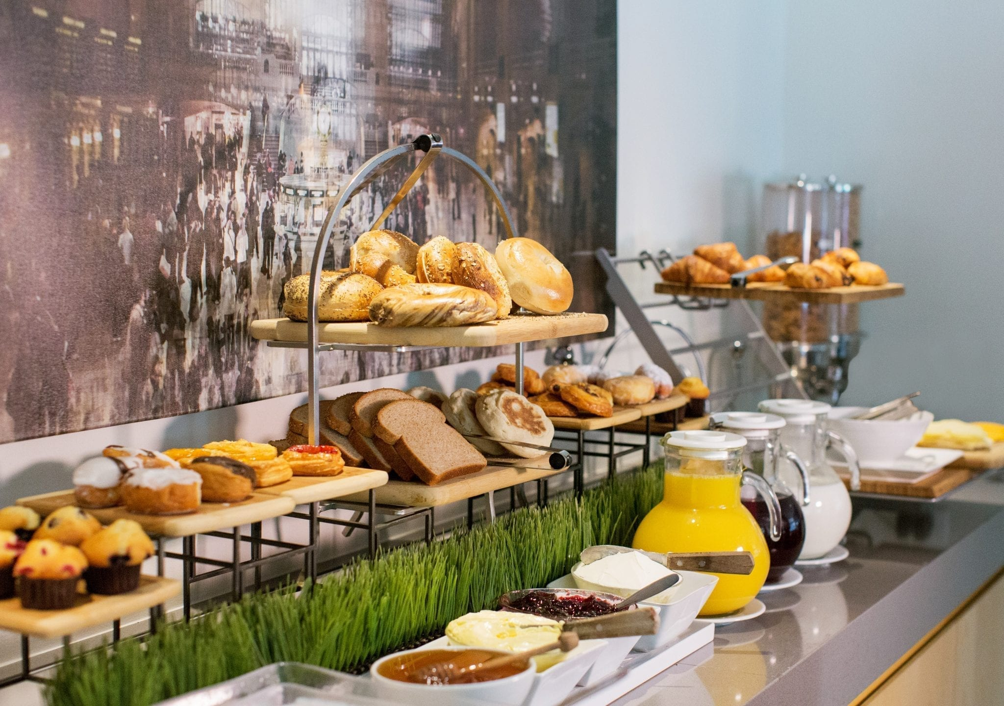 View of a long table containing different breads for breakfast service.