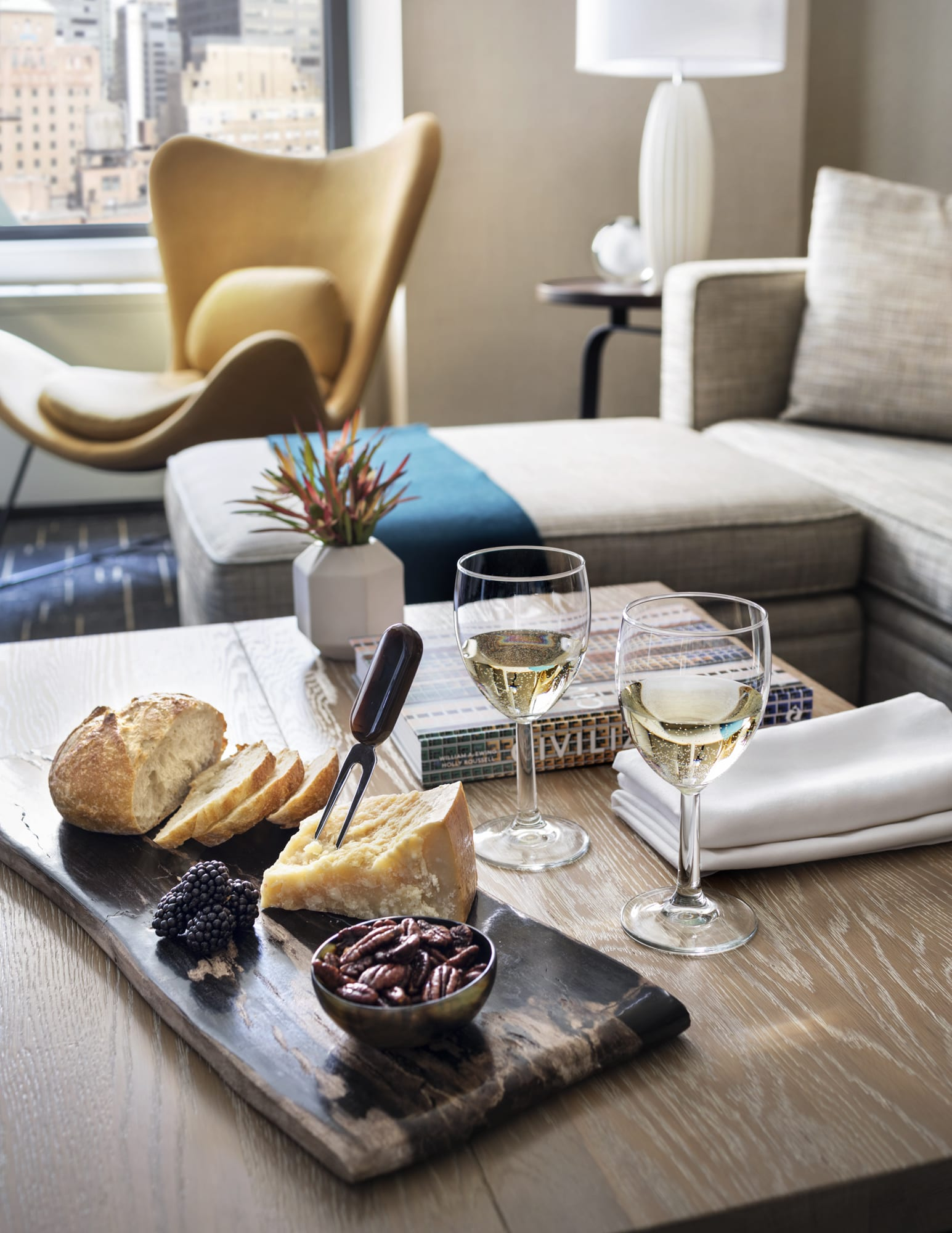 Shelburne Hotel & Suites Cheese Board And Glasses Of Wine In One Bedroom Apartment Living Room